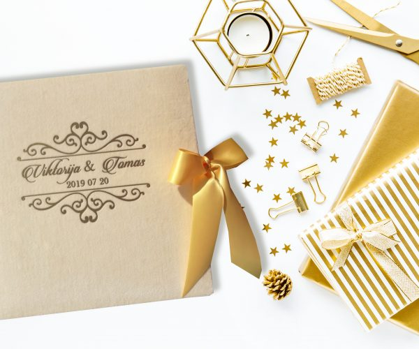 Flat lay of Christmas or Party Background with Golden Deco Accessories, Wrapping Paper, Wrapped Gifts, Ribbons and Candle on White Table. Process of wrapping gifts. Horizontal